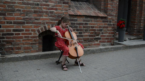 Young girl play with cello violoncello old town street... Stock Video Footage