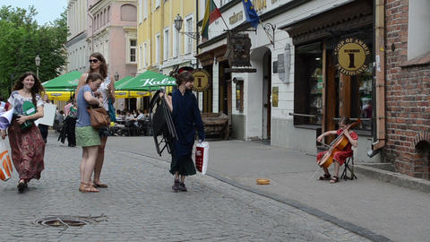 Young girl play with cello violoncello old town street Stock Video Footage