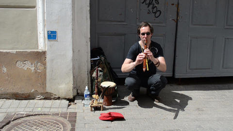 Man play with flute pipe in old town street event Stock Video Footage