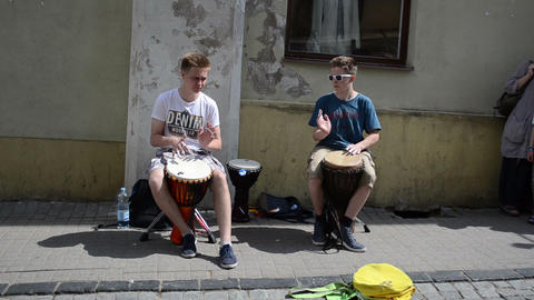 young kids teenagers play drum rhythm outdoor. street music day Footage