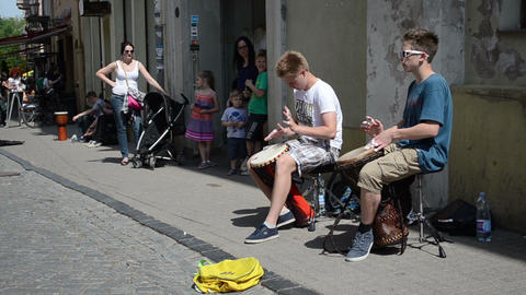 young kids teenagers play drum rhythm and public people Stock Video Footage