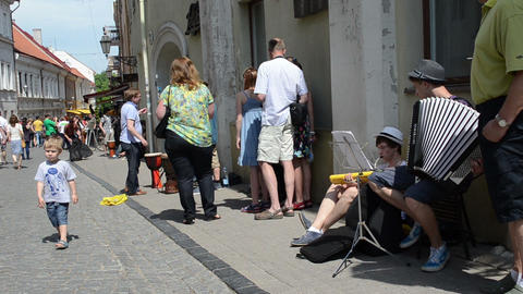 street musicians play music entertain people in street... Stock Video Footage