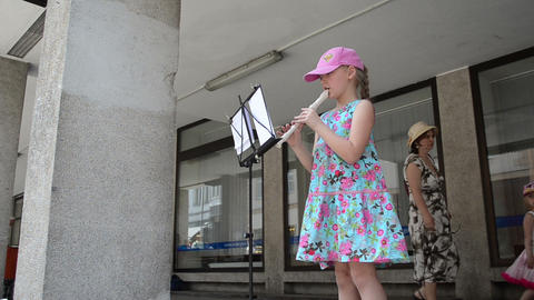 Girl in dress play with flute fife pipe in old town... Stock Video Footage