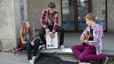 teenagers play drum guitar sing and public audience in street Footage