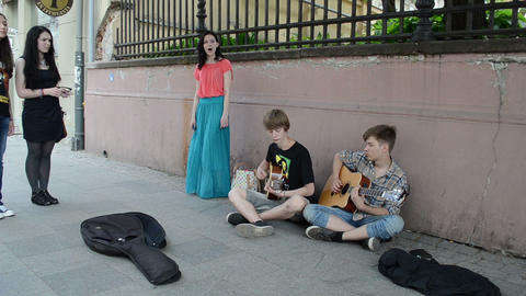 young guitarists play guitar and girl in long skirt sing Stock Video Footage