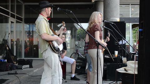 street musicians play country music sing for public audience Stock Video Footage