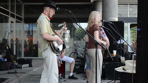 street musicians play country music sing for public audience Footage