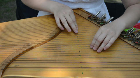 girl hands play Baltic psaltery string musical instrument Stock Video Footage