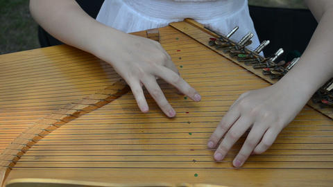 girl hands play Baltic psaltery string musical instrument Footage