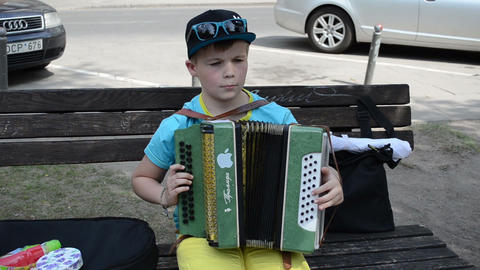 cute boy child play with accordion squeeze-box in music day Stock Video Footage