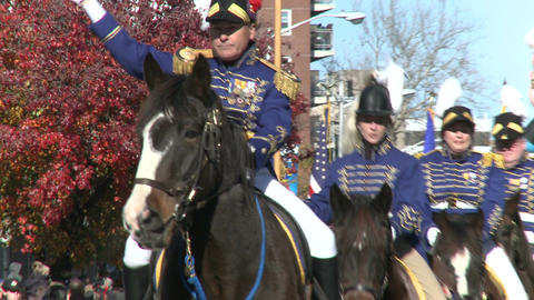 Horsemen march in parade Stock Video Footage