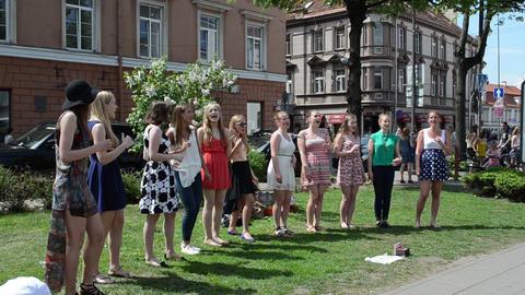 pretty chorus girls sing glee song in public street festival Stock Video Footage