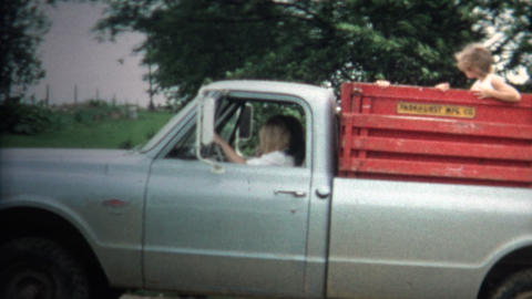 (8mm Vintage) 1966 Girls Riding Back Of Farm Truck in... Stock Video Footage