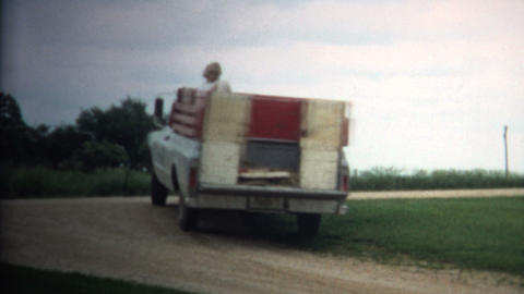 (8mm Vintage) 1966 Girls Riding Back Of Farm Truck in Iowa, USA Footage