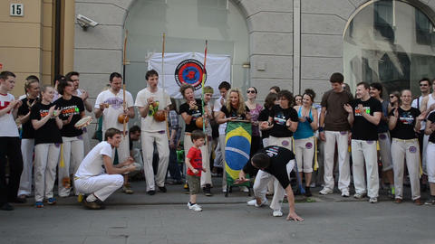 public audience enjoy capoeira performance little kid man fight Footage