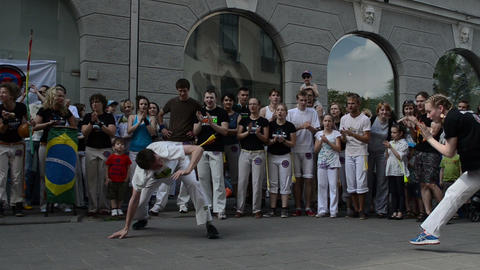 Man and woman perform capoeira dance in center of singing... Stock Video Footage