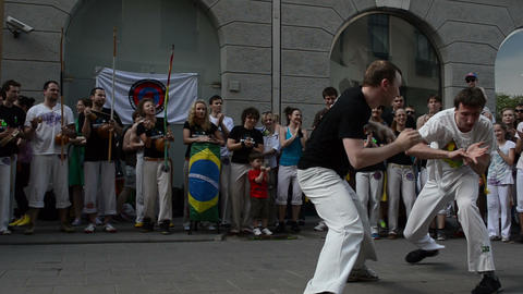 capoeira. men fight. People play instrument, sing Footage