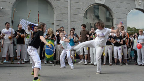 capoeira. men fight. People play instrument, sing Stock Video Footage