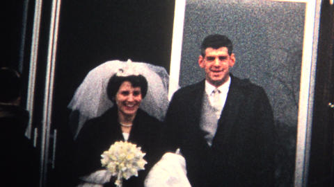 (8mm Vintage) 1966 Groom Kissing Bride Wedding Cake New... Stock Video Footage