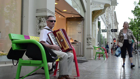 senior man play music with accordion. outdoor street festival Footage
