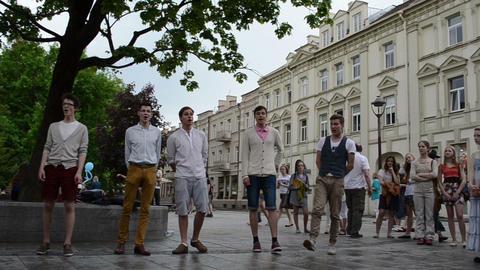 chorus boys teenagers sing glee songs in public street festival Footage