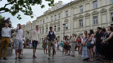 chorus boys teenagers sing glee songs in public street... Stock Video Footage
