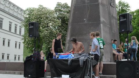 Teen boys play mix dj club music outdoor street music festival Footage