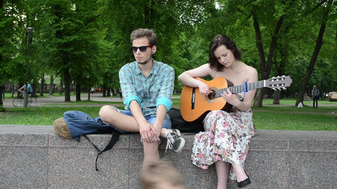 Young musician people play play guitar and sing street... Stock Video Footage
