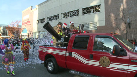 Clowns and confetti at parade Stock Video Footage