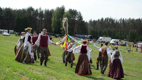 cheerful people dance around horse figure in festival Run... Stock Video Footage