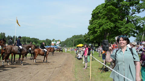 People audience enjoy ranger police riders in horse festival Footage