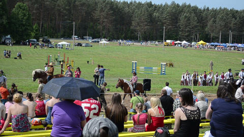 Panorama of people enjoy various riders in annual horse... Stock Video Footage