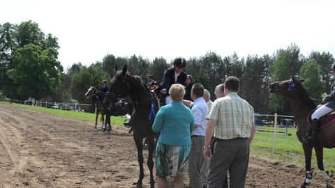 Woman rider get awards cup for horse race from politician... Stock Video Footage