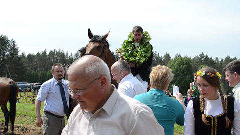 man rider winner on horse get awards cup from politician people Footage