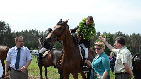man rider winner on horse get awards cup from politician... Stock Video Footage