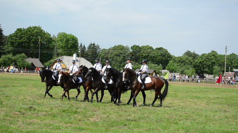 Mounted police horse riders run in circle parade show Stock Video Footage