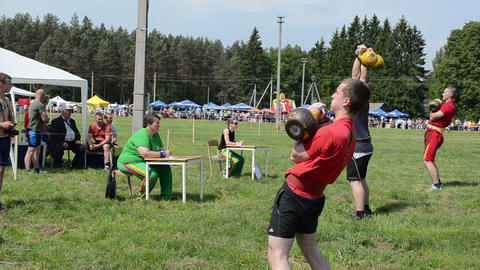 men lift heavy weights in competitions and judges grading... Stock Video Footage