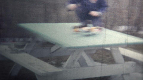(8mm Vintage) 1965 Kid Playing Toy Model Airplane Stock Video Footage
