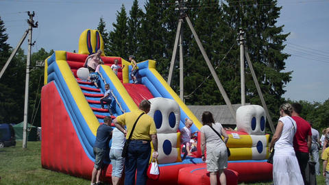 children play on inflatable blow-up toy playground in fair Stock Video Footage