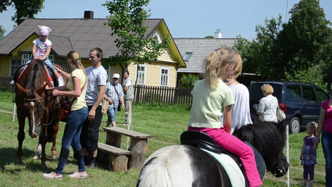 follow scene teenager leads girl rein horseback riding pony Footage