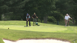 Male golfers tee off (1 of 4) Stock Video Footage