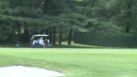 Golf carts drive near the green Stock Video Footage