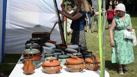 crockery pots hand craft sold in outdoor market fair and... Stock Video Footage