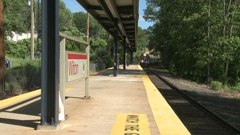 Train arriving at station Stock Video Footage