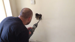 Plumber drill the wall to find water leak Footage
