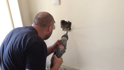 Plumber drill the wall to find water leak Stock Video Footage