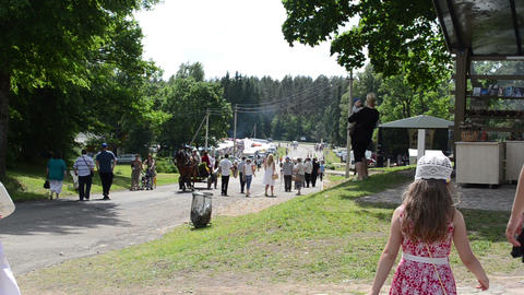 People recreate in rural festival. Horse carriage carry... Stock Video Footage