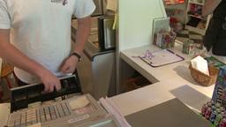 Man giving change to customer Footage