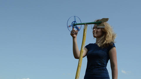 beautiful woman play with spin windmill pinwheel toy on... Stock Video Footage