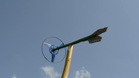 Closeup of handmade pinwheel windmill spin in wind on blue sky Footage